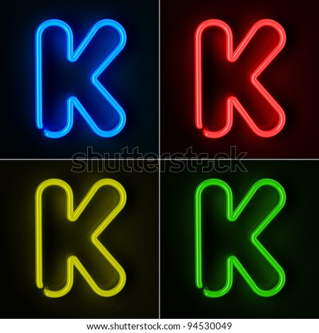 Highly detailed neon sign with the letter K in four colors - stock photo