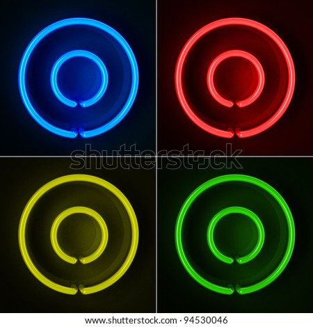 Highly detailed neon sign with the letter O in four colors - stock photo