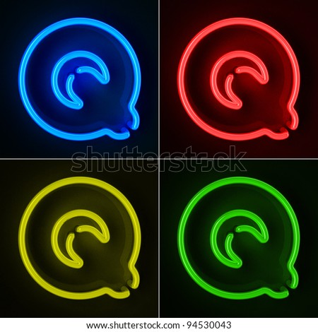 Highly detailed neon sign with the letter Q in four colors - stock photo
