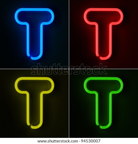 Highly detailed neon sign with the letter T in four colors - stock photo