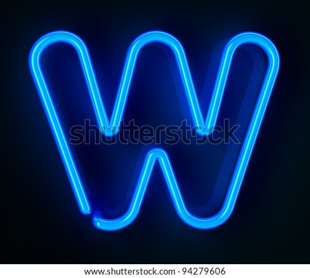 Highly detailed neon sign with the letter W - stock photo