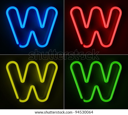 Highly detailed neon sign with the letter W in four colors - stock photo