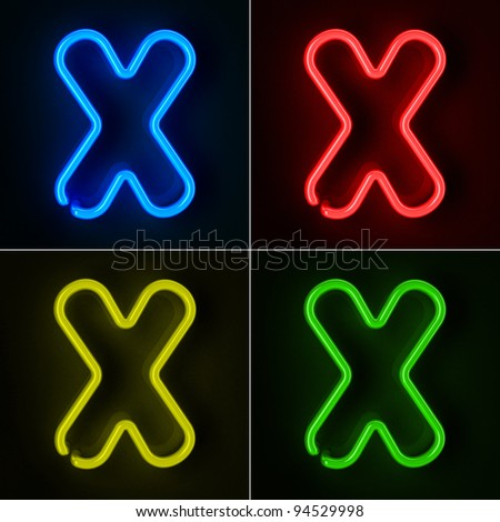 Highly detailed neon sign with the letter X in four colors - stock photo