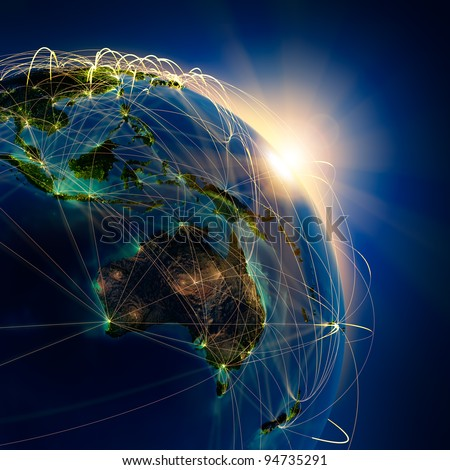 Highly detailed planet Earth at night, lit by the rising sun, illuminated by light of cities. Earth is surrounded by a luminous network, representing the major air routes based on real data - stock photo