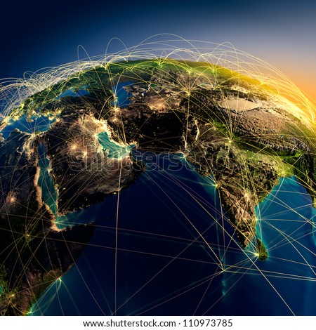 Highly detailed planet Earth at night with embossed continents, illuminated by light of cities. Earth is surrounded by a luminous network, representing the major air routes based on real data - stock photo