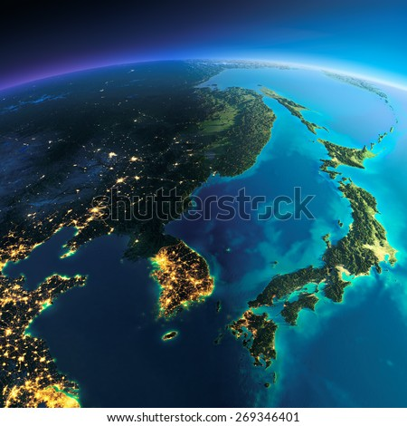 Highly detailed planet Earth. Night with glowing city lights gives way to day. The boundary of the night & day. Korea and Japan. Elements of this image furnished by NASA - stock photo