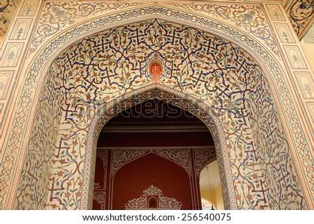 Highly elaborate painting at entrance of Maharaj Sawai Mansingh II Museum, City Palace, Jaipur, Rajasthan, India, Asia - stock photo