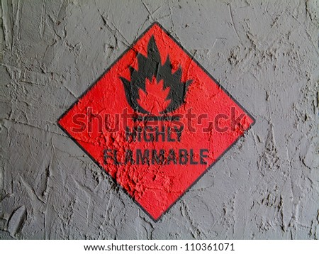 Highly flammable sign drawn on wall - stock photo