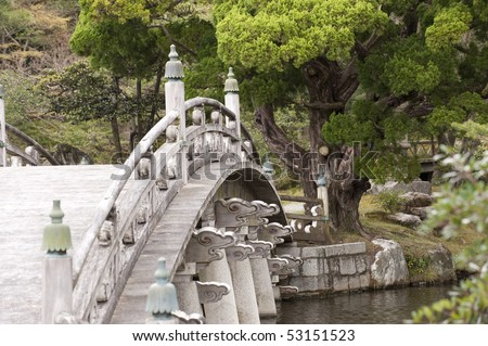 Highly ornamented Japanese bridge, made of wood, part of Kyoto's Imperial Palace complex, Japan.