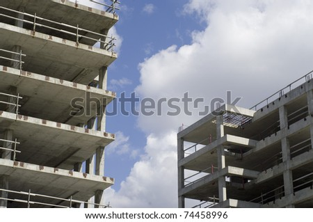 highrise building  construction work in progress. - stock photo
