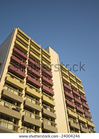 Highrise Building with blue sky as background and colorful balconys - stock photo