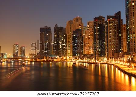 Highrise buildings at Dubai Marina illuminated at night - stock photo