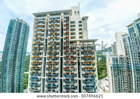 Highrise housing dominates Hong Kong's limited land mass of 1,104 km. With a population of over 7 million, Hong Kong is one of the most densely populated areas in the world. - stock photo