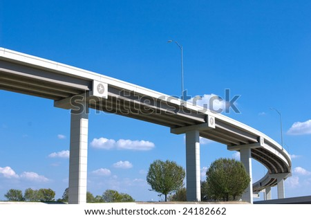 Highway against blue sky - stock photo