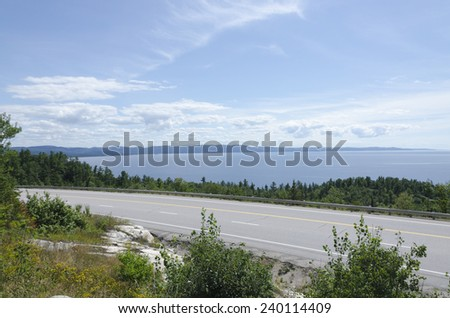 Highway along blue water of Superior Lake shore - stock photo