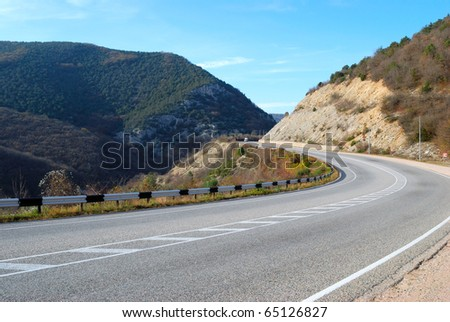 highway among the mountains and blue sky