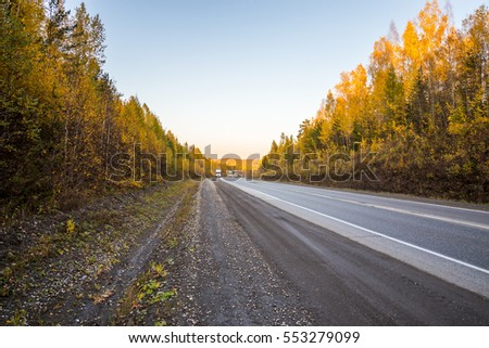 Highway and natural landscape. Warm time of the year.