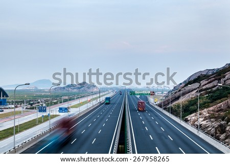 Highway at night in long exposure - stock photo