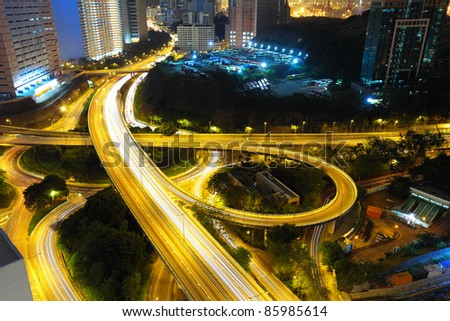 Highway at night in modern city - stock photo