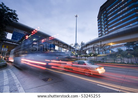 Highway at night with light trails in hong kong,china - stock photo