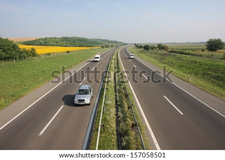 highway at sunny day classic scene of a highway in rural area - stock photo