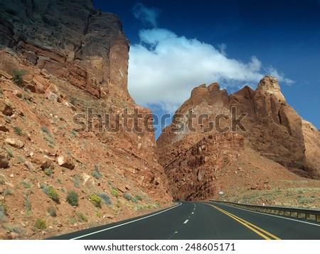 Highway between two rocks - stock photo