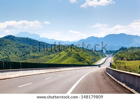 Highway, blue sky, sunny weather - stock photo