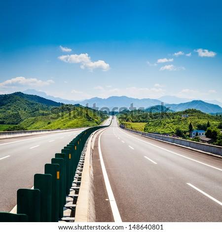 Highway, blue sky, sunny weather - stock photo
