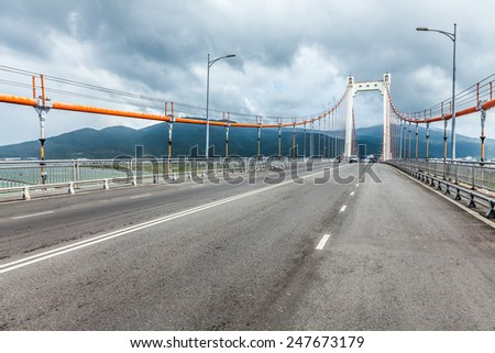 Highway, bridge and cloudy - stock photo