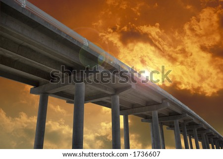 Highway bridge at evening with yellowish clouds - stock photo