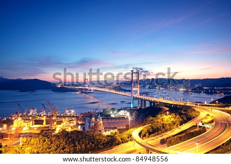 highway bridge at night in hong kong - stock photo