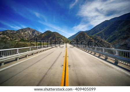 Highway bridge leads into the wilderness of Angeles National Forest in southern California.