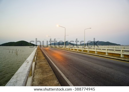 Highway Bridge with island and lake view In Evening:select focus with shallow depth of field:ideal use for background.
