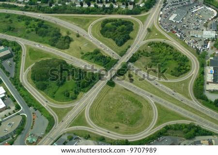 Highway clover leaf interchange. - stock photo