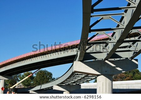 Highway Construction - two flyover bridges being built. - stock photo
