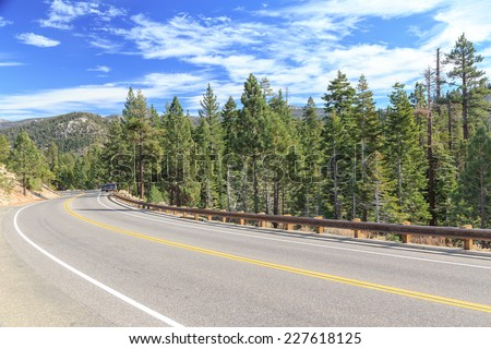 Highway curves through the mountains at Tahoe National Forest, California, USA. - stock photo