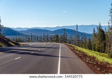 Highway curving through a dramatic nature scene in Central Oregon - stock photo
