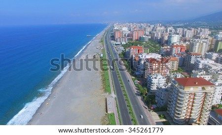 Highway D-400 near sea beach in Alania resort city at summer sunny day. Aerial view videoframe - stock photo