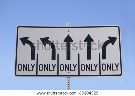 Highway directional  sign indicating three options, left turn, right turn, straight only - stock photo