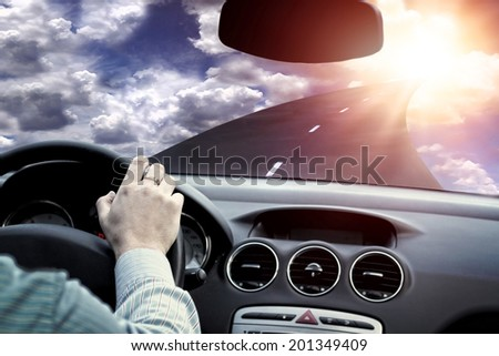 highway driving toward the sun - stock photo