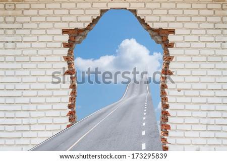 highway going through a broken brick wall,.  Concepts for Success - stock photo