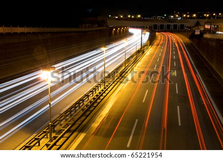 highway in berlin at night with motion blur - stock photo