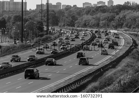 Highway in black and white with number plates and car logos removed - stock photo