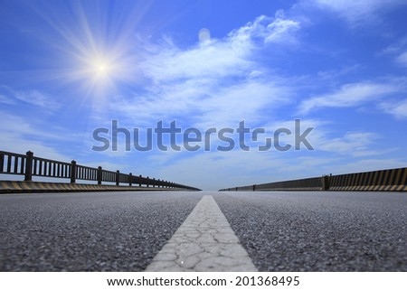 highway in steppe against a blue sky - stock photo