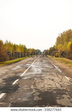 Highway in the autumn forest