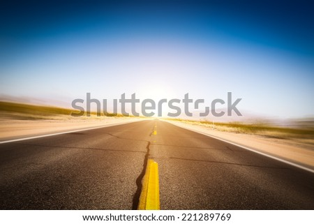 highway in the desert with signs of high speed - stock photo