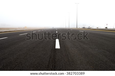 Highway in the fog - stock photo