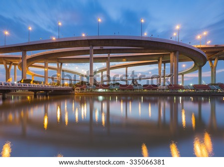 Highway interchange curved river front view during twilight - stock photo