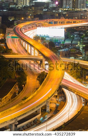 Highway intersection overpass close up night view, long exposure   - stock photo