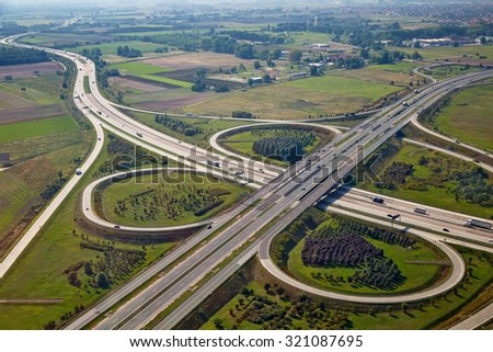 Highway intersection viewed from the air - stock photo